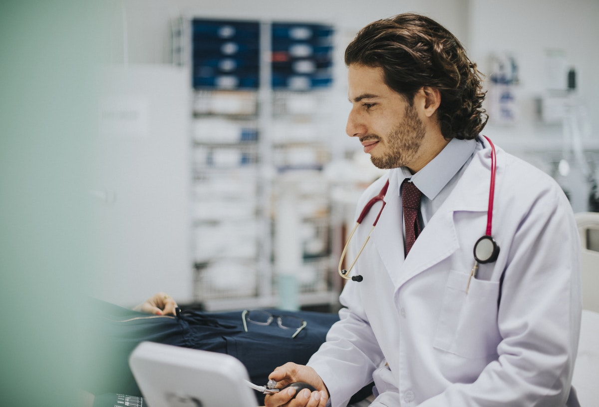 Doctor Performing Biometric Screening