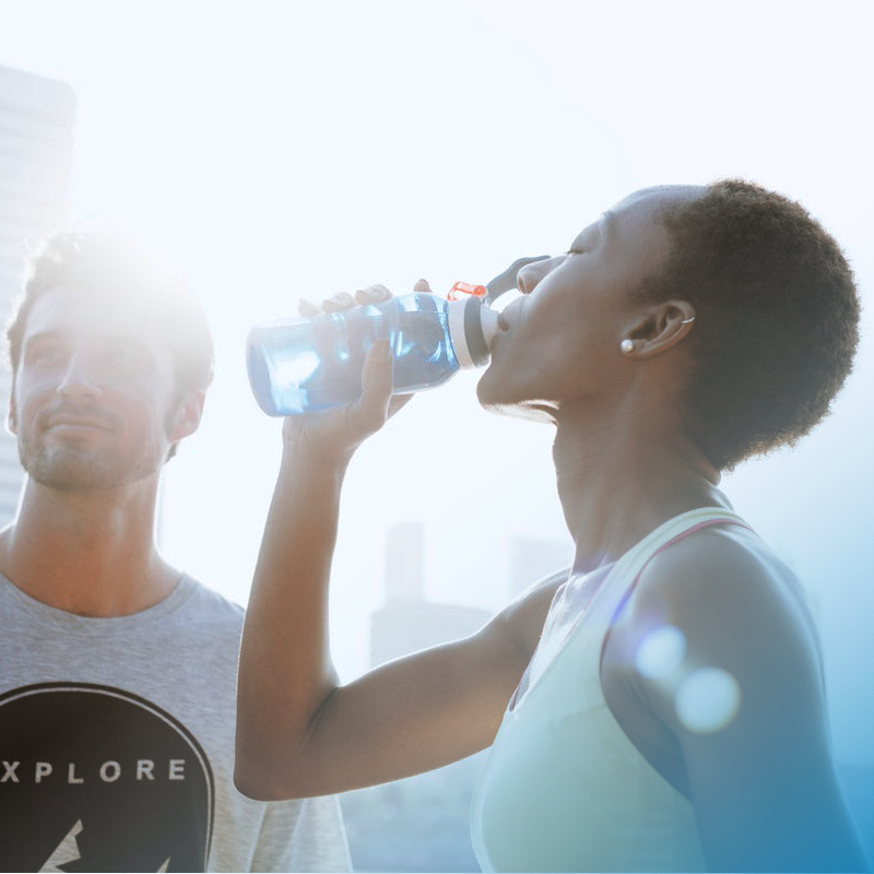 Fit woman drinking a water bottle