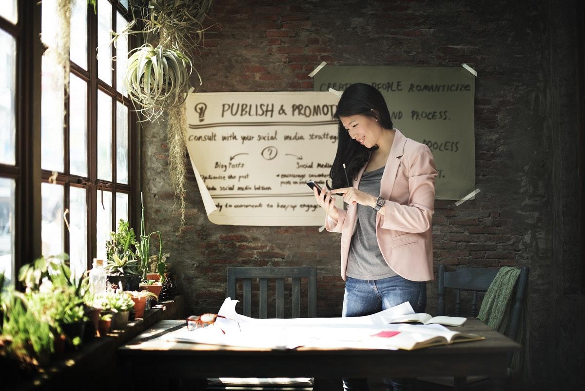 Businesswoman Holding Using Smart Phone Working