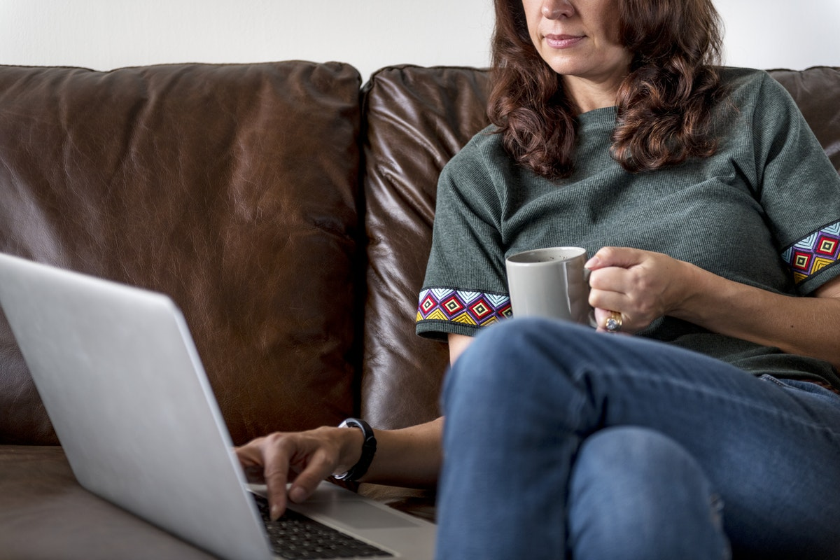 Woman working from home with coffee